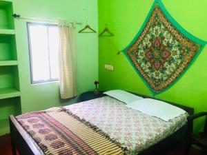 A bed or beds in a room at Elara Beach View HomeStay