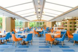 Un restaurante o sitio para comer en Hong Kong Gold Coast Hotel