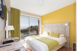 Un ou plusieurs lits dans un hébergement de l'établissement Hôtel-Restaurant Bois Joly