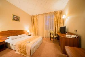 Кровать или кровати в номере Отель Богемия на Вавилова