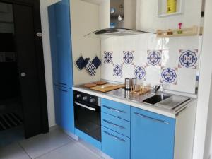 A kitchen or kitchenette at B&B Suite Vela Bianca