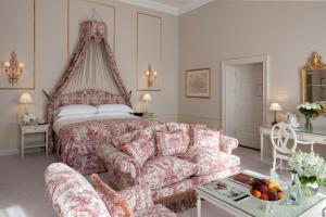 A bed or beds in a room at The Merrion Hotel