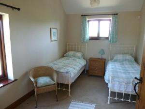 A bed or beds in a room at Smallthorns Barn