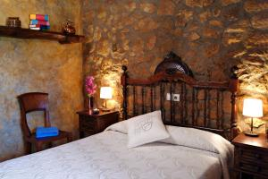Cama o camas de una habitación en Casa Rural Ca La Siona