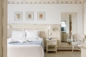 A bed or beds in a room at IL Campanário Villaggio Resort Suites - Jurerê Internacional