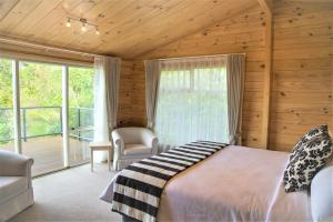 A bed or beds in a room at Waitakere Resort & Spa