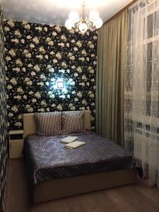 A bed or beds in a room at The Hotel Uyut
