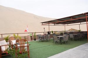 Restaurant ou autre lieu de restauration dans l'établissement Hostal Huacachina Sunset