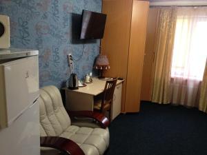Телевизор и/или развлекательный центр в Гостиница Сибирячка