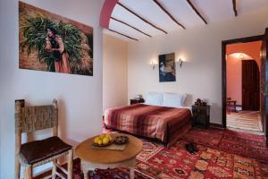 Ein Bett oder Betten in einem Zimmer der Unterkunft Le Village du Toubkal