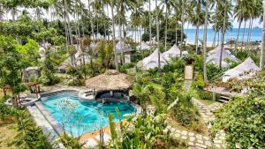 A view of the pool at Nacpan Beach Glamping or nearby