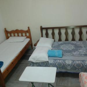 A bed or beds in a room at Amilia HOME near the port Piraeus