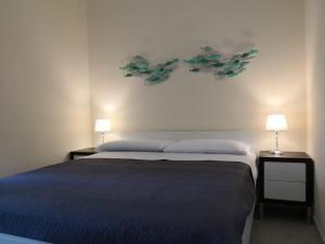 A bed or beds in a room at Casa Umberto