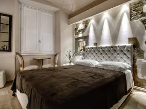 Cama o camas de una habitación en Piccolo Signoria Apartment