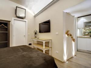 Una televisión o centro de entretenimiento en Piccolo Signoria Apartment