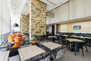 A restaurant or other place to eat at Holiday Inn Express Bangkok Siam, an IHG Hotel