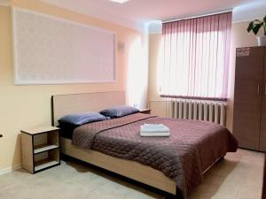 A bed or beds in a room at Home One Lux