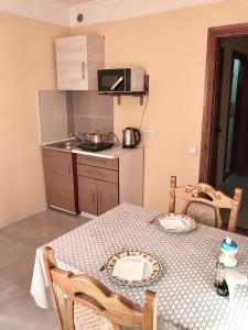 A kitchen or kitchenette at Home One Lux