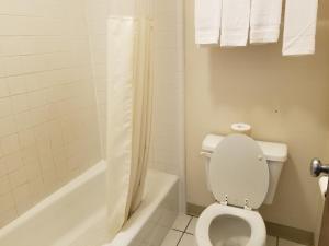 A bathroom at TravelStar Inn & Suites