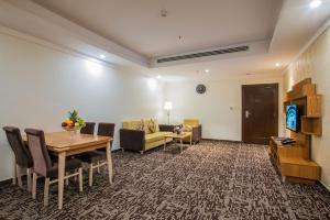 Uma área de estar em Le Park Concord Hotel