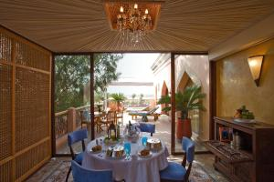 A restaurant or other place to eat at Es Saadi Marrakech Resort - Palace