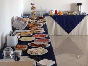 Breakfast options available to guests at Hotel Castello Budoni
