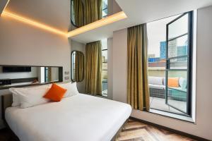 Letto o letti in una camera di New Road Hotel