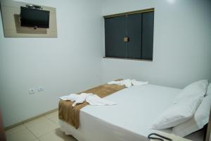 A bed or beds in a room at Tio San Hotel