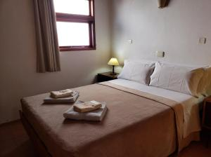 Una cama o camas en una habitación de Cabañas de las Mellizas