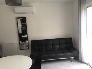 A seating area at Maison avec Jardin/Piscine - Quartier résidentiel