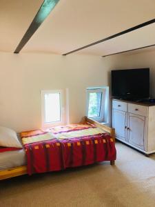 Ein Bett oder Betten in einem Zimmer der Unterkunft Marschenhof am See Xanten