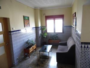 A seating area at Hostal Arias
