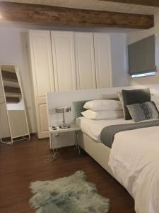 Un ou plusieurs lits dans un hébergement de l'établissement Casa Cara
