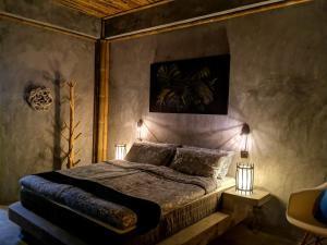 Ein Bett oder Betten in einem Zimmer der Unterkunft The Lazy Lodge