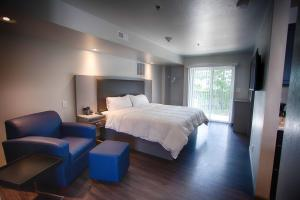 A bed or beds in a room at Z Loft Extended Stay Hotel