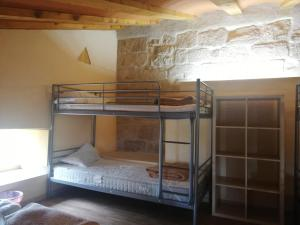 A bunk bed or bunk beds in a room at Casón Salto de Roldán