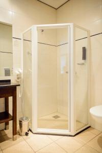 Een badkamer bij Fletcher Hotel Restaurant Amersfoort
