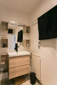 A bathroom at Duplex Plaisir