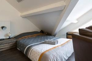 A bed or beds in a room at Duplex Plaisir