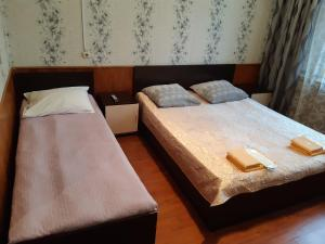 A bed or beds in a room at Fili Inn