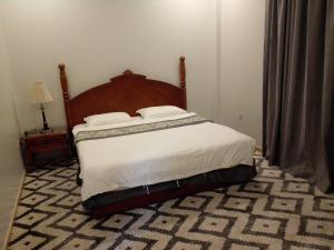 Cama ou camas em um quarto em Lotus Furnished Apartments