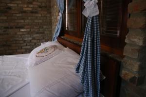 Postel nebo postele na pokoji v ubytování Robinzonski smještaj Marcin salaš