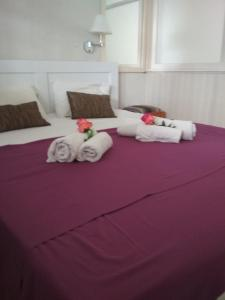 A bed or beds in a room at Alkyonis Apartments