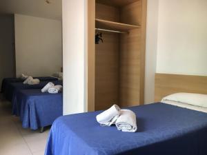 Cama o camas de una habitación en Hotel Armonia