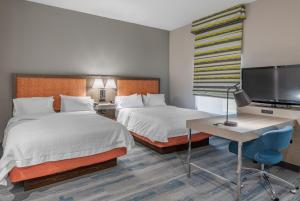 A bed or beds in a room at Hampton Inn Brownwood