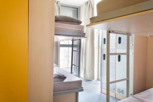 A bunk bed or bunk beds in a room at Urbany Hostel Barcelona