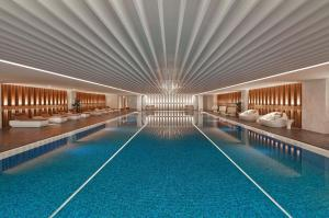 The swimming pool at or near Shanghai Marriott Hotel Parkview