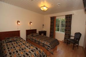 Ein Bett oder Betten in einem Zimmer der Unterkunft Hotel Sininen Helmi