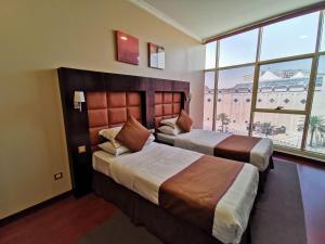 Cama ou camas em um quarto em Traveller Inn Hotel Appartments