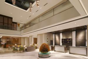 The lobby or reception area at Four Points By Sheraton Hotel and Serviced Apartments